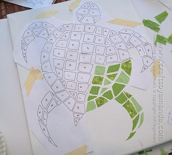 Add the fabric pieces to the mosaic turtle