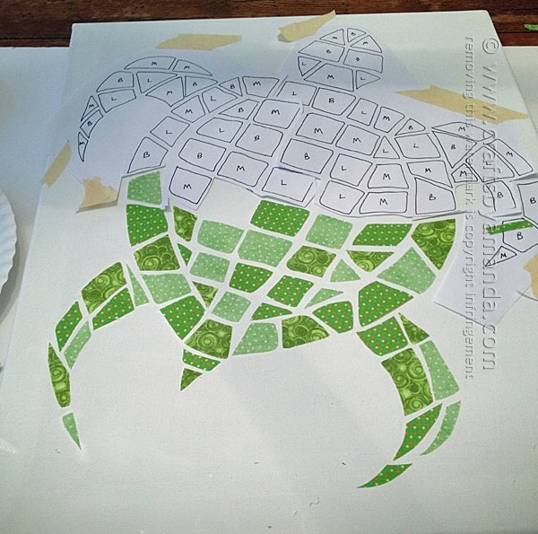 Continue adding fabric pieces until you complete the mosaic turtle