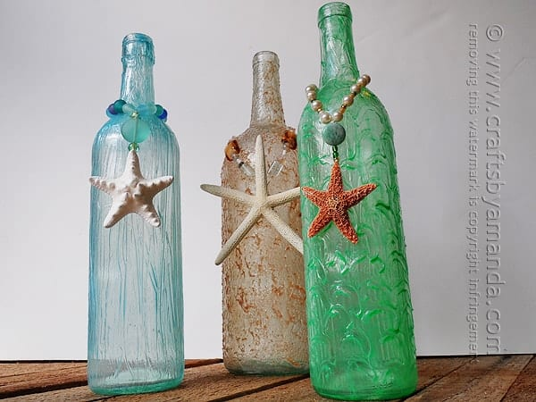 Wine bottle crafts are really popular right now, and it's summertime, so beach crafts are a hit too. I'll show you how to make these beachy wine bottles!