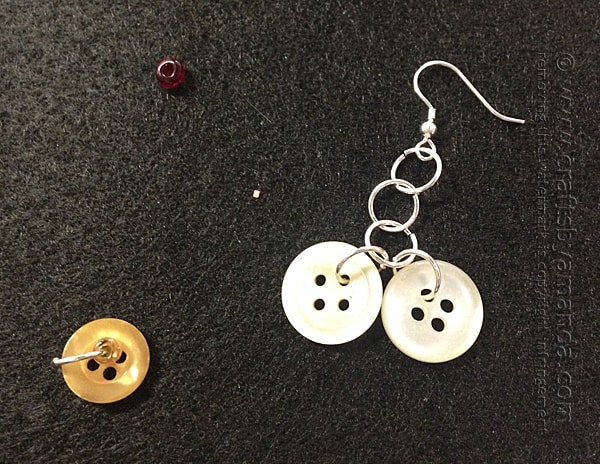Add to button rings to the bottom jump ring on the earring