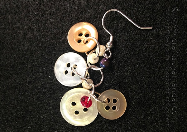 Continue adding button rings to the earring