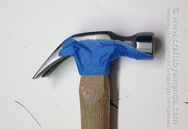 Cover the hammer claw with painter's tape