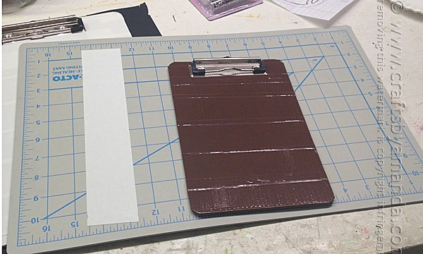 Cover the clipboard in brown duct tape