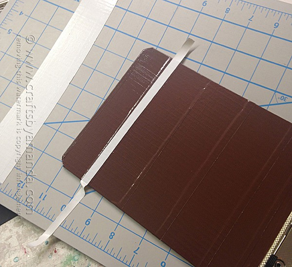 Add strips of white duct tape to the clipboard