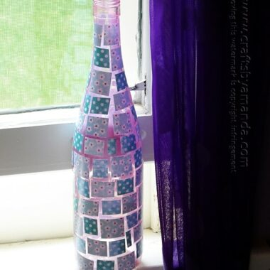 Pretty! Uses enamel paints, Mod Podge and scrapbook paper. - Mosaic Wine Bottle craft from Amanda Formaro of Crafts by Amanda
