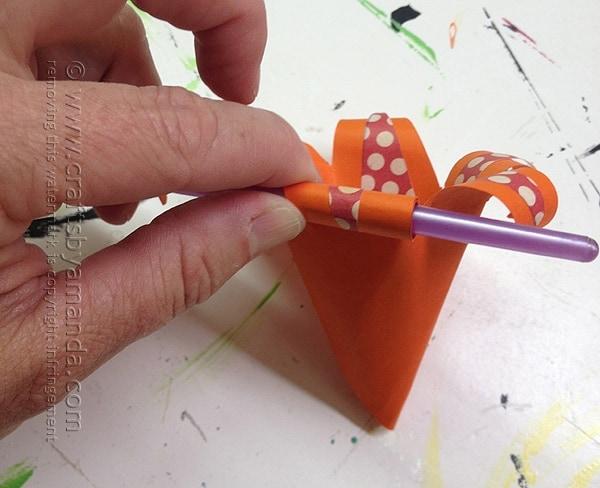 Curl the flower petals around a pen