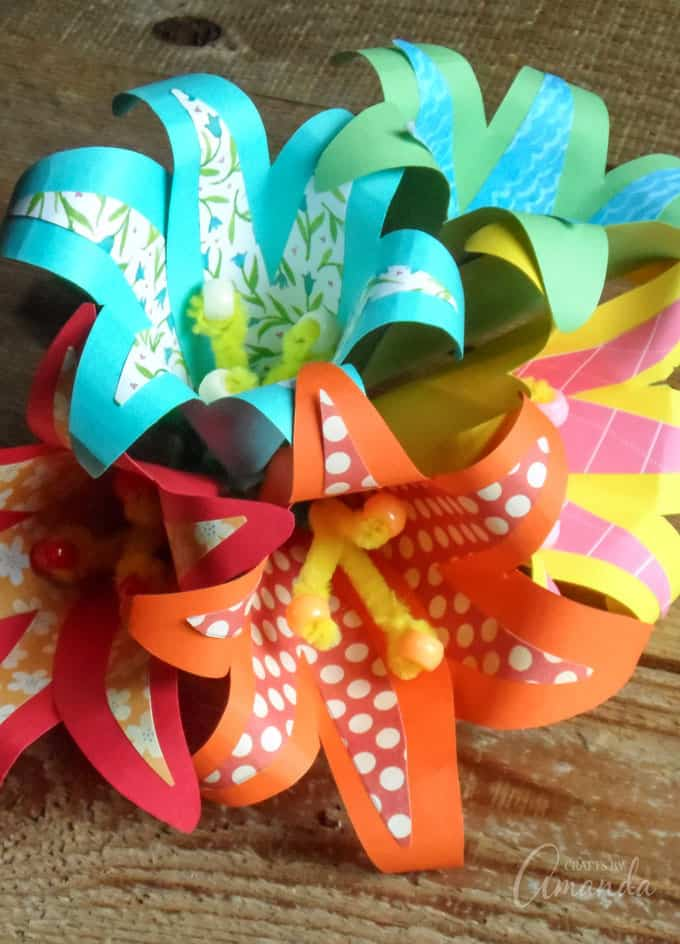 5 different color tropical paper flowers