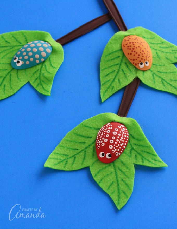 Bugs made from plastic spoons on a felt leaf