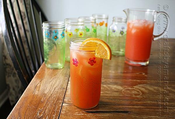 Mason jar drinking glasses with orange wedge