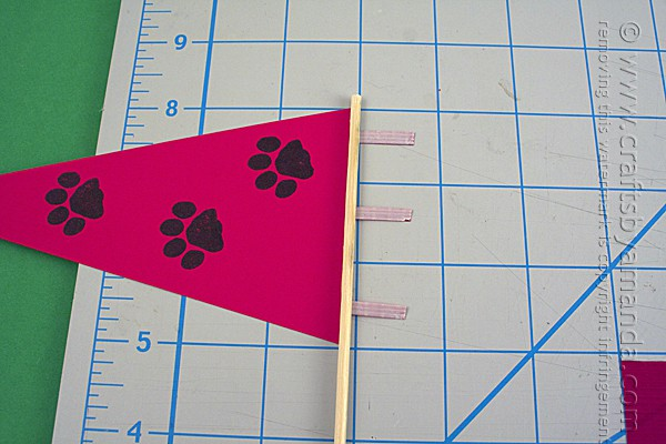 add a paw print stamp to the paper