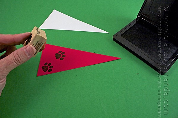 adding paw print stamps to the paper flags