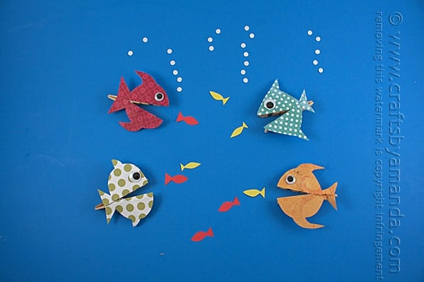 school of colorful patterned fish made from scrapbook paper and clothespin
