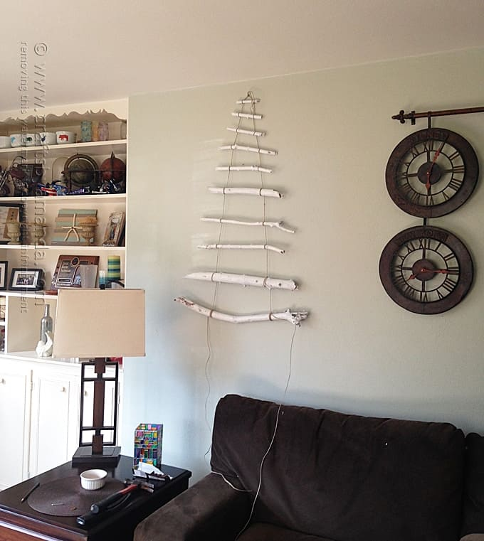 unfinished coastal branch tree for Christmas on wall
