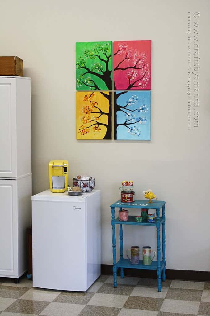 Simple This button tree wall art is made from four canvases paint and colorful buttons