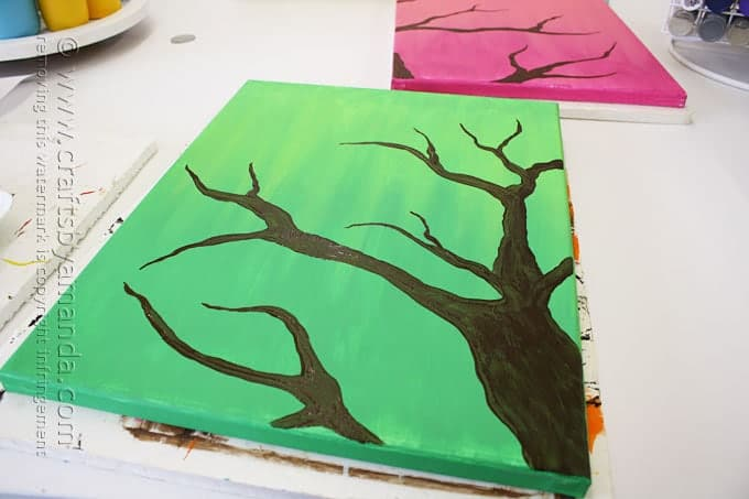 silhouette of tree branch on green canvas