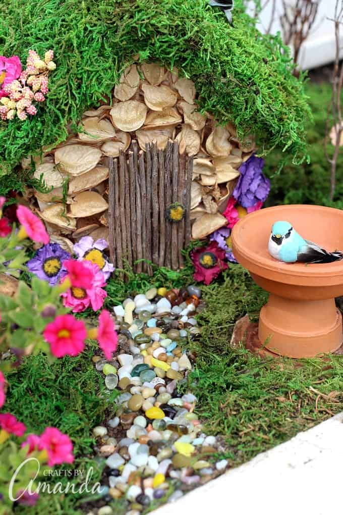 How to Start a Fairy Garden. pebble walk way and terra cotta bird bath