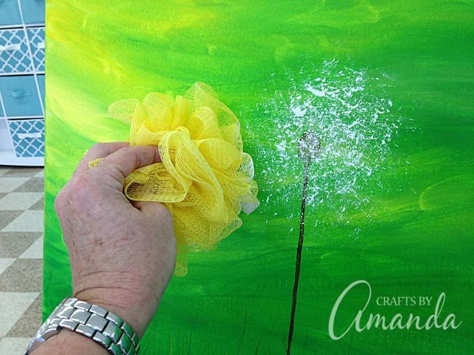 Dab loofah onto painting to make a dandelion head