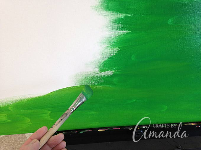 using a large paint brush to paint