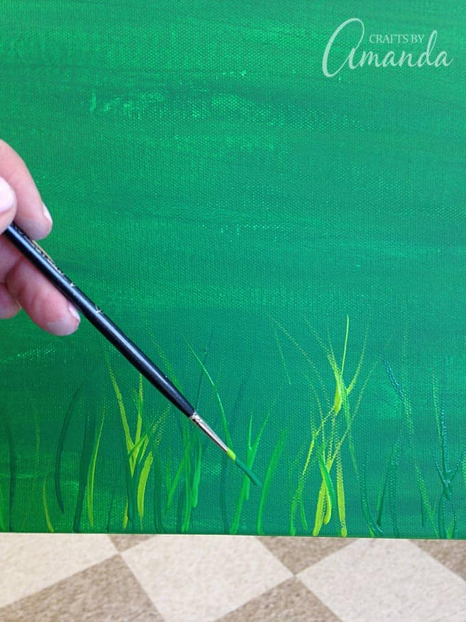 Paint on grass with small paint brush