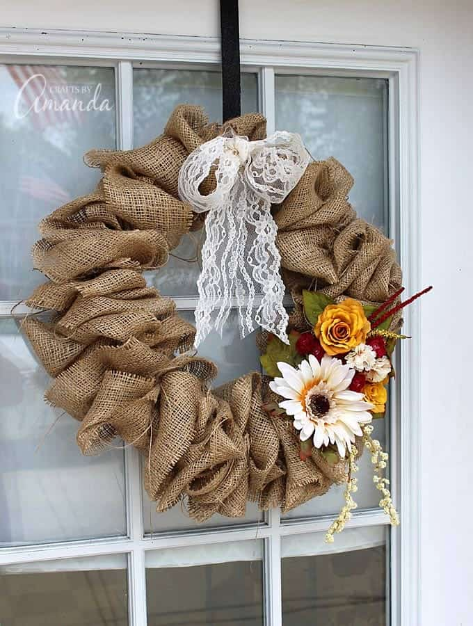 burlap wreath with a coat hanger on door