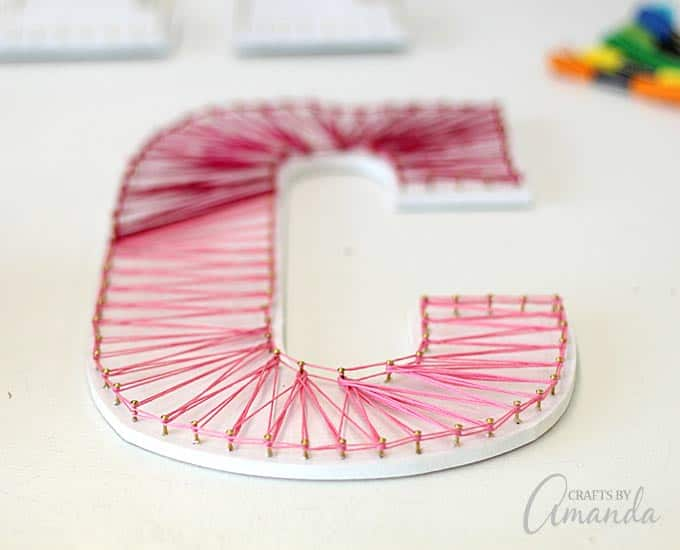 up close pink and red string art