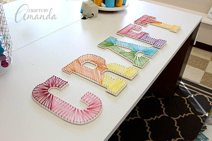 colorful string art wall letters by amanda formaro of crafts by amanda