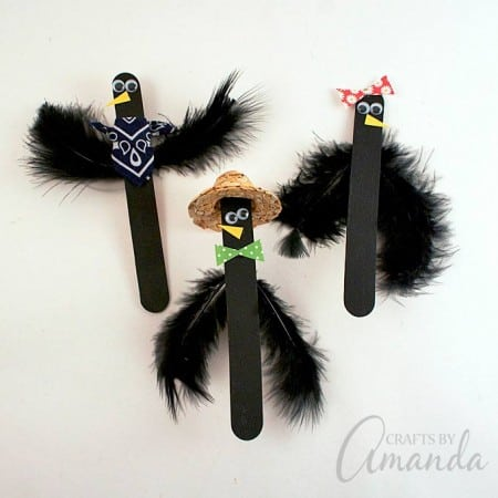 These popsicle stick crows are perfect to use as puppets, or to tuck into plants as part of your fall decor!