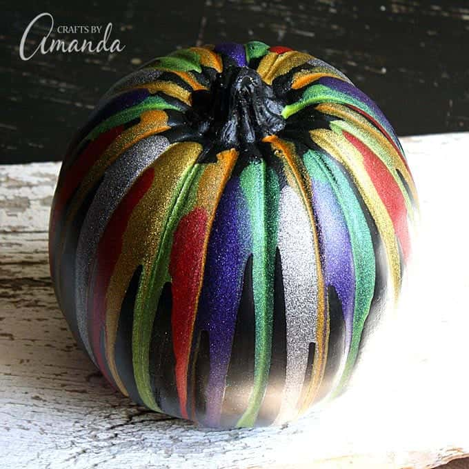 Add an easy, colorful touch to your Halloween decor with this glitter drip pumpkin!