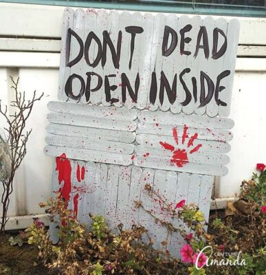 "How to make a walking dead door that says ""Don't Open, Dead Inside"" as a Halloween prop. The perfect companion to my Barbie Zombies!"