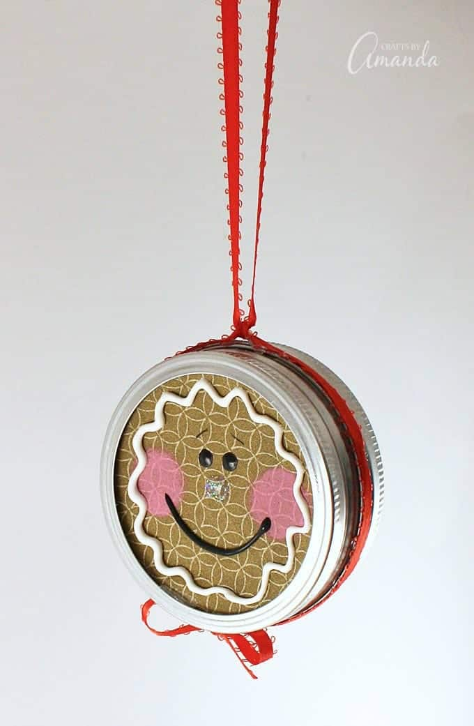 Turn a canning jar lid into a sweet gingerbread man with this canning lid ornament project!