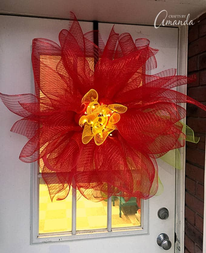 deco mesh poinsettia wreath on door
