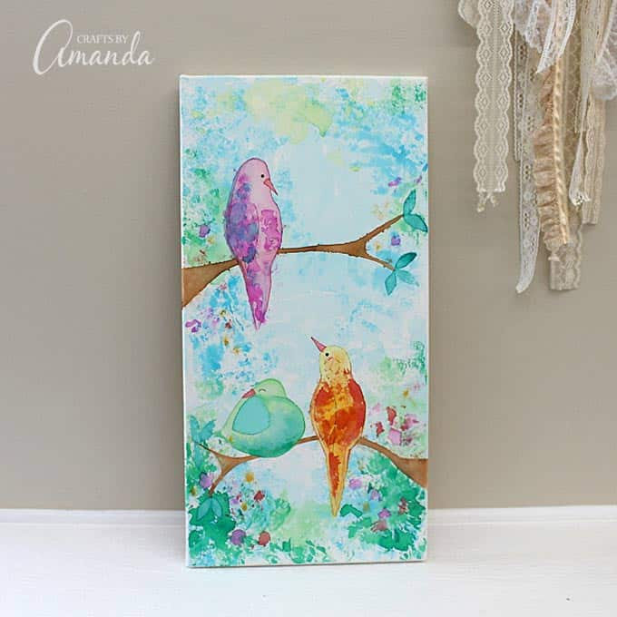 Canvas with birds made from bleeding tissue paper