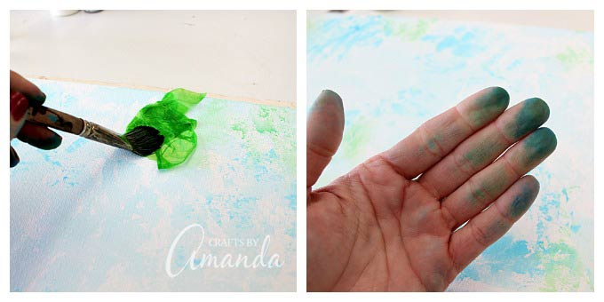 Pressing on bleeding tissue paper to canvas