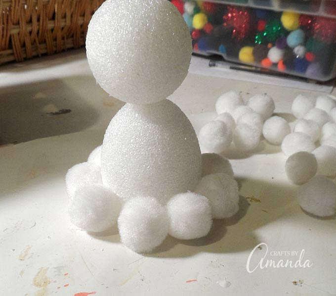 This fluffy pom pom snowman is a fun winter craft that you can enjoy no matter what the weather - no snow required!