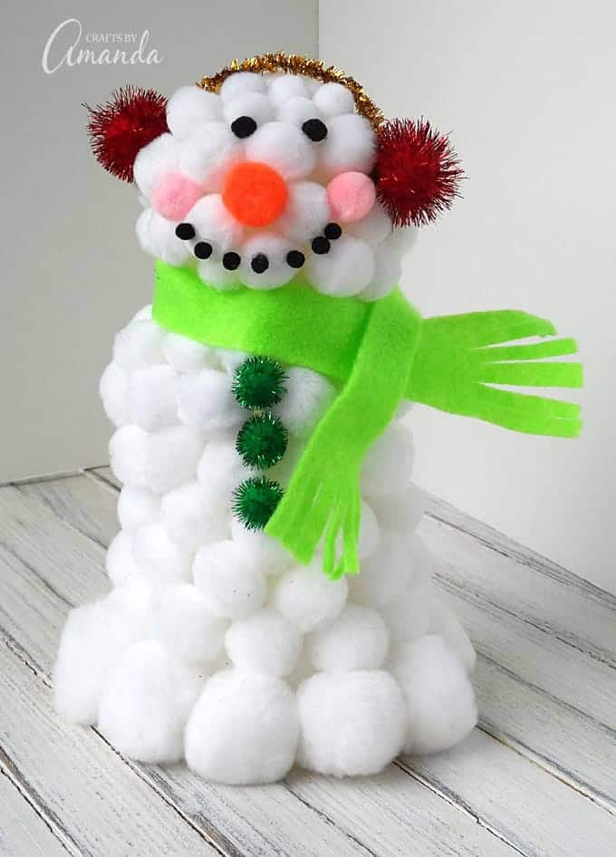This fluffy pom pom snowman is a fun winter craft for kids. It's easy to make and uses craft supplies you likely have around the house already.