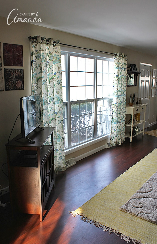 See this gorgeous living room makeover from Crafts by Amanda. A bright cheery living room with lots of windows!