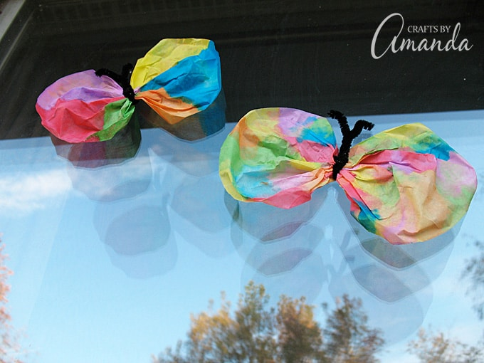 watercolor butterflies made from coffee filters on window