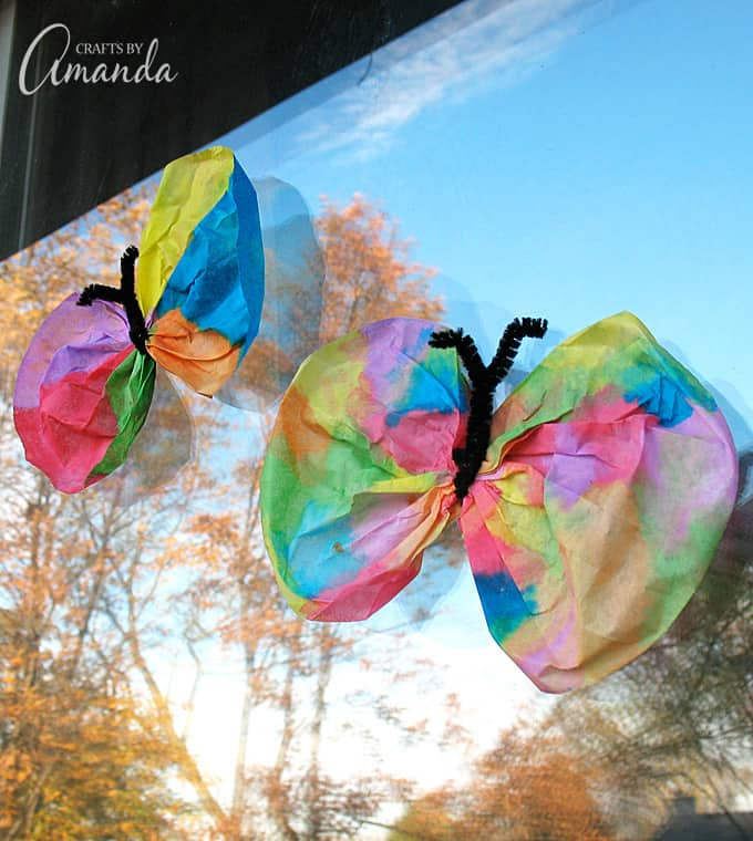 butterflies on a window made from watercolored coffee filters
