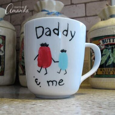 This adorable Father's Day mug uses a child's fingerprint to create a cute daddy and me message. The perfect keepsake gift for dad!