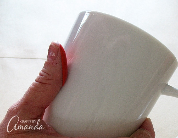 Dip finger in paint then apply gently to coffee mug