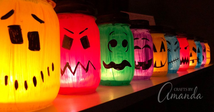 4611dc9ab94 Halloween Luminaries  spooky colorful painted jars to light up the night