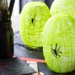 These spider nest lanterns are super cute and a fun Halloween craft for kids. Display them at your Halloween party, they will be a big hit!