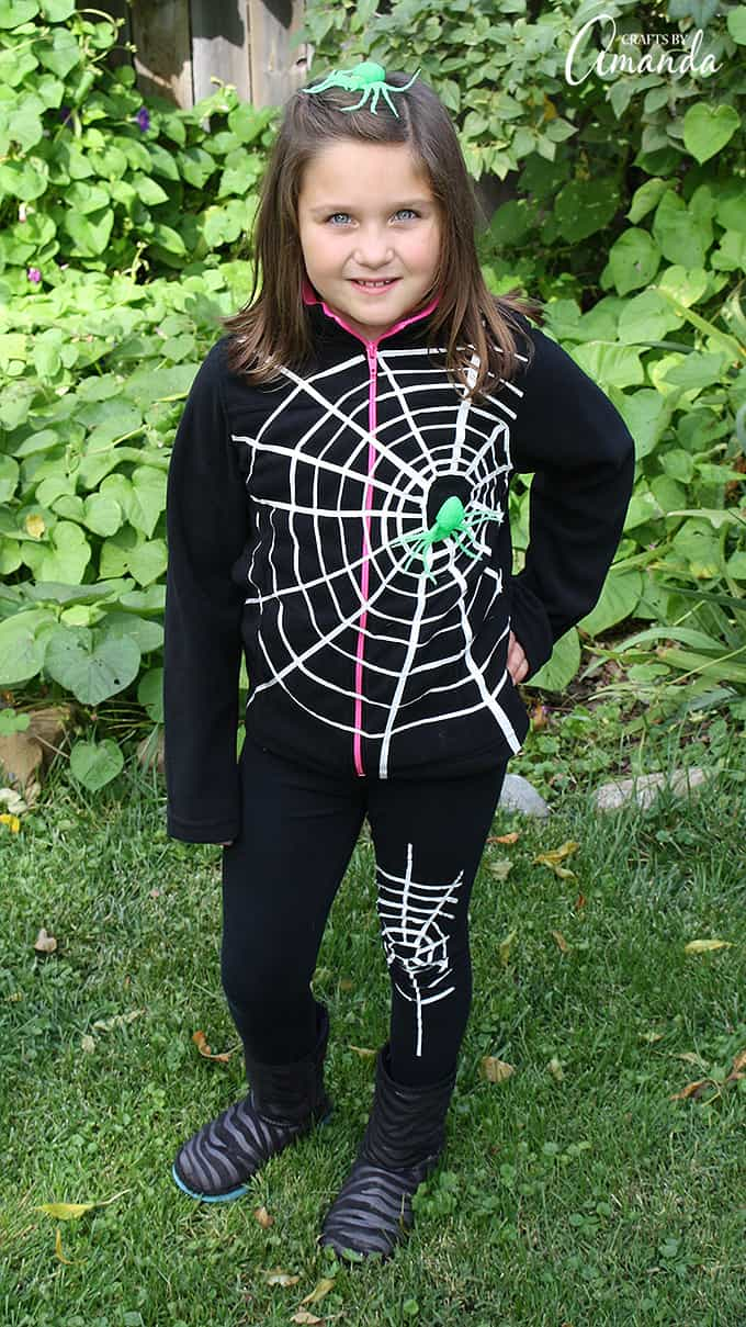 Use duct tape to create this super easy spiderweb costume, perfect for a last minute costume idea. Later remove the duck tape and your clothes are fine!