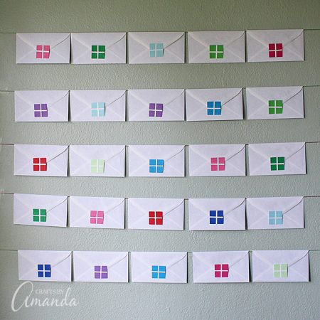 Hang your envelope advent calendar using wall putty and string