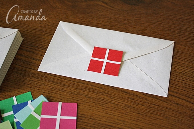 Press the present onto the envelope flap, do not lick and seal the envelope.