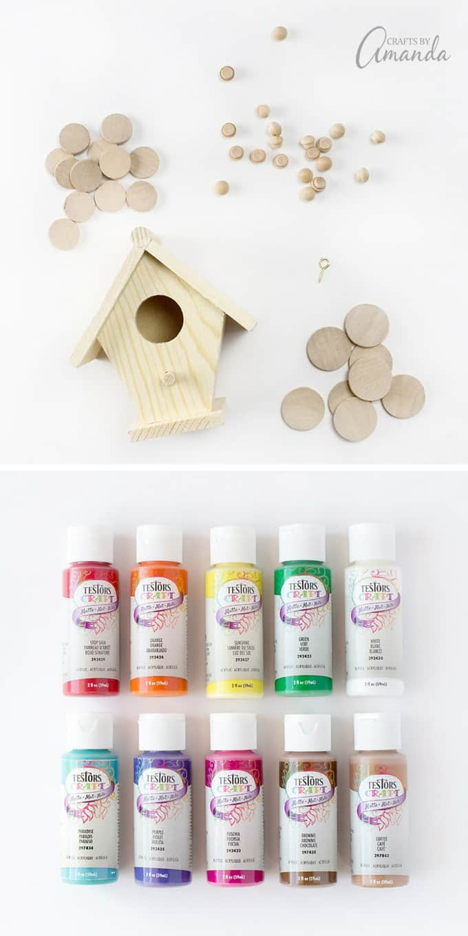 After gathering your supplies, paint the decorative dowel on the top of the birdhouse white.