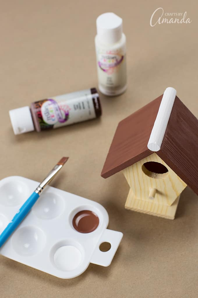 Paint the rest of the birdhouse brown.