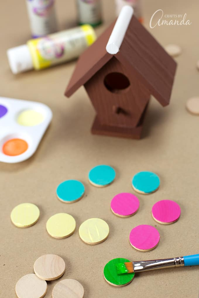 While the birdhouse is drying, paint the 1 x 1/8 inch wooden circles in wafer candy inspired colors.