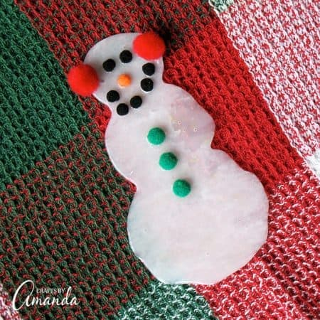 Turn ordinary glue into an adorable glue snowman. Great as a gift topper, part of a homemade garland or as a snowman ornament for the Christmas tree.
