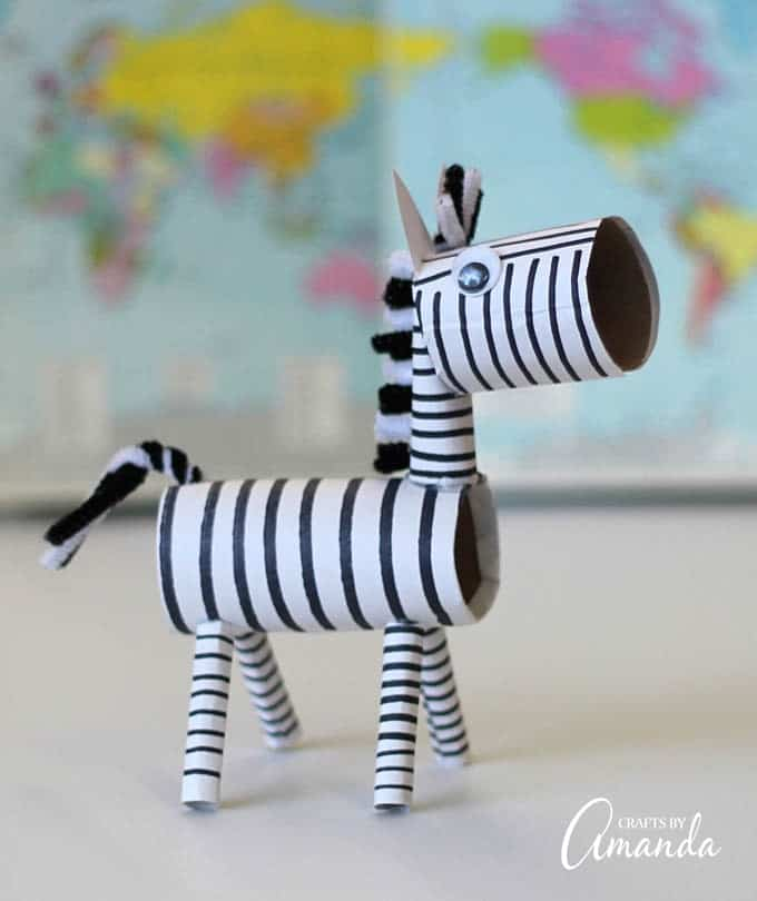 I have made lots and lots of cardboard tube crafts in my day! While I haven't done it yet, I could certainly put together a list of cardboard tube animals from A to Z, so why not be backwards and start my list with a zebra?